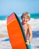 Happy Young boy having fun at the beach on vacation, Stock Photo