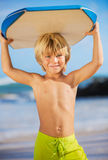 Happy Young boy having fun at the beach on vacation, Royalty Free Stock Photography