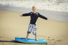 Happy Young boy having fun at the beach on vacation, Royalty Free Stock Image