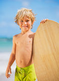 Happy Young boy having fun at the beach on vacation Stock Images
