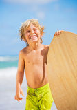 Happy Young boy having fun at the beach on vacation Royalty Free Stock Photos