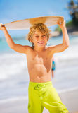 Happy Young boy having fun at the beach on vacation Royalty Free Stock Photo