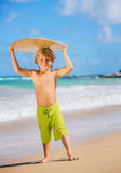 Happy Young boy having fun at the beach on vacation Royalty Free Stock Image