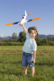 Happy Young boy and his new RC plane. Smiling happy young boy preparing to launch RC plane Royalty Free Stock Images