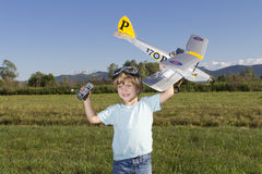 Happy Young boy and his new RC plane stock photos