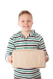 Happy young boy holding a gift box over the white Stock Photography