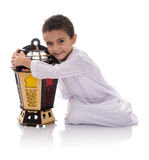 Happy Young Boy Hugging Ramadan Lantern. Isolated on White Background Stock Photo
