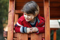 Happy young boy on jungle gym Royalty Free Stock Photo