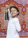 Happy Young Boy with Lantern Celebrating Ramadan Stock Photo