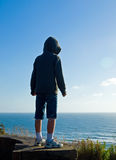 Happy, Young Boy Looking Over the Ocean Stock Photos