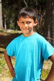 Happy young boy outdoor in forest sunshine Stock Images