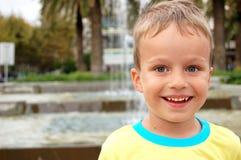 Happy young boy outdoors enjoying summer Stock Image