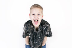 Happy young boy play the ape isolated on white background. Happy young boy play the ape, shows tongue and grimace on a t-shirt, composition isolated over the Stock Images