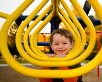 Happy young boy on playground Stock Photos