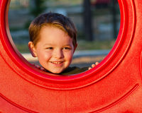 Happy young boy on playground Stock Images