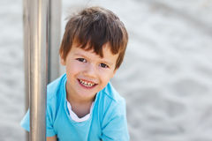 Happy young boy at playground Stock Photos