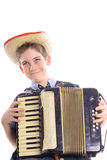 Happy young boy playing an accordion Stock Photography