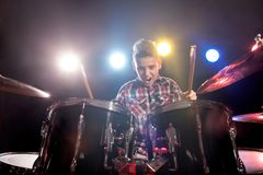 Young boy playing drums. Happy young boy playing drums stock photos