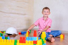 Happy young boy playing with his building blocks Stock Images