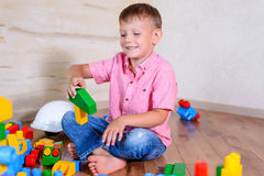 Happy young boy playing with his building blocks Royalty Free Stock Images