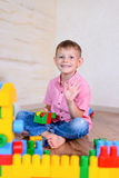 Happy young boy playing with his building blocks Stock Image