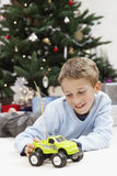 Happy Young Boy Playing With Toy Car At Home Royalty Free Stock Image