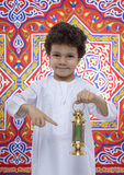 Happy Young Boy Pointing at Ramadan Lantern Royalty Free Stock Photo
