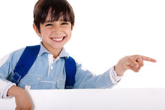 Happy young boy pointing to copy sapce Stock Photo
