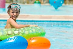 Happy young boy in pool Royalty Free Stock Images