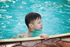 Happy young boy in the pool Royalty Free Stock Photography