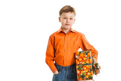 Happy young boy with a present box smiles isolated Royalty Free Stock Images
