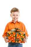 Happy young boy with a present box smiles isolated.  Royalty Free Stock Images