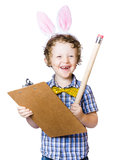 Boy writing Easter list Royalty Free Stock Photos