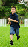 Happy young Boy running. Happy young Child running on grass and smiling Royalty Free Stock Photos