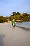 Happy young boy is running along. The beautiful beach Stock Photo