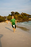 Happy young boy is running along. The beautiful beach Stock Photography