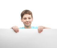 Happy young boy with a sheet of paper Stock Photography