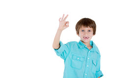 Happy young boy showing OK sign Royalty Free Stock Images