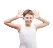 Happy young boy in a sleeveless shirt Royalty Free Stock Photo