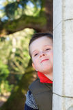 Happy young boy smiling in an outdoor scene Royalty Free Stock Image