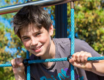 Happy young boy smiling at the park in a outdoor day Royalty Free Stock Images