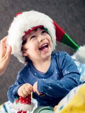Happy boy playing with Christmas decorations. Happy young boy smiling, playing and having fun with Christmas decorations Royalty Free Stock Photo