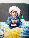 Happy boy playing with Christmas decorations. Happy young boy smiling, playing and having fun with Christmas decorations Stock Image