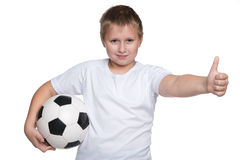 Happy young boy with soccer ball Stock Photography