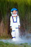 Happy young boy in a spaceman suit Royalty Free Stock Photo