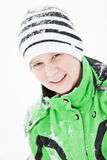 Happy young boy sprinkled with winter snow Stock Images