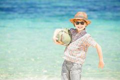Happy young boy staying on beautiful ocean beach Stock Photo