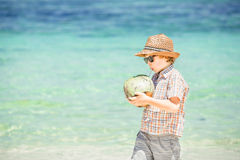 Happy young boy staying on beautiful ocean beach Royalty Free Stock Photo