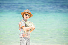 Happy young boy staying on beautiful ocean beach Royalty Free Stock Photos