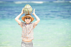 Happy young boy staying on beautiful ocean beach Royalty Free Stock Photography